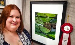 KC Hulsman next to her award-winning photo.