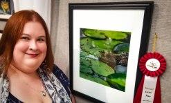 KC Hulsman next to her award-winning photo.