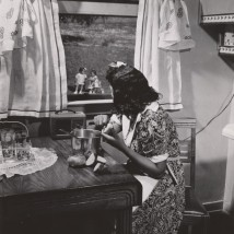 Anacostia, D.C. Frederick Douglass housing project. Mother watching her children as she prepares the evening meal, June 1942